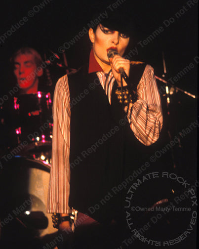 Photo of Siouxsie Sioux performing onstage in 1980 by Marty Temme