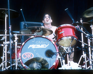 Photo of drummer Phil Varone of Skid Row in concert in 2000 by Marty Temme