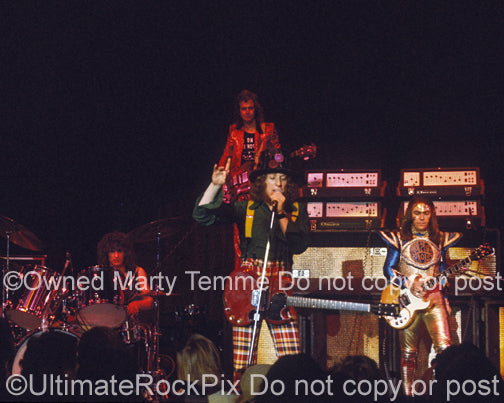 Photo of Don Powell, Dave Hill, Noddy Holder and Jim Lea of Slade in 1973 by Marty Temme