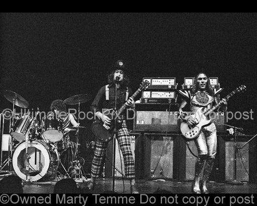 Photo of Don Powell, Noddy Holder and Dave Hill of Slade in concert in 1973 by Marty Temme