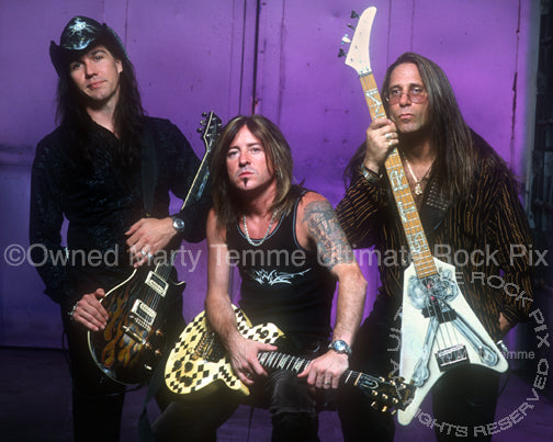 Photo of Mark Slaughter, Jeff Bland and Dana Strum of Slaughter in 2003 by Marty Temme