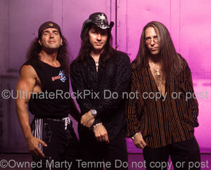 Photo of Bobby Rock, Mark Slaughter and Dana Strum of Slaughter during a photo shoot in 2003 in Hollywood, California by Marty Temme