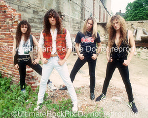 Photo of the band Slaughter during a location shoot in Detroit in 1990 by Marty Temme