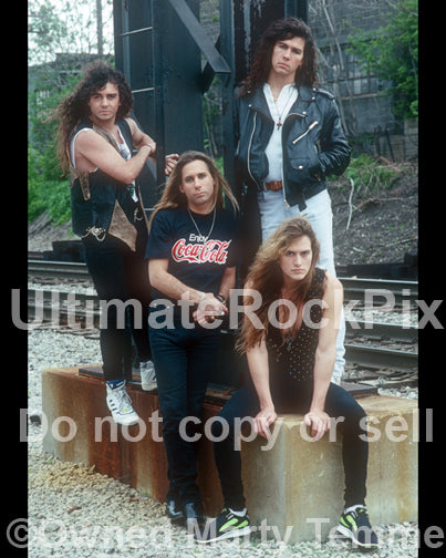 Photo of the band Slaughter during a location shoot in Detroit, Michigan in 1990 by Marty Temme
