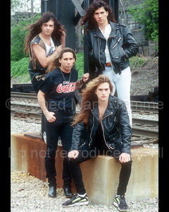 Photo of the rock band Slaughter during a location photo shoot in Detroit, Michigan in 1990 by Marty Temme