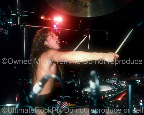 Photo of Blas Elias of Slaughter during a concert in Detroit in 1990 by Marty Temme
