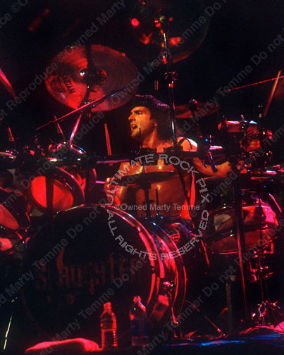 Photo of drummer Bobby Rock of Slaughter in concert in 2003 by Marty Temme