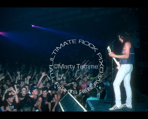 Photo of Mark Slaughter of Slaughter onstage in 1990 by Marty Temme