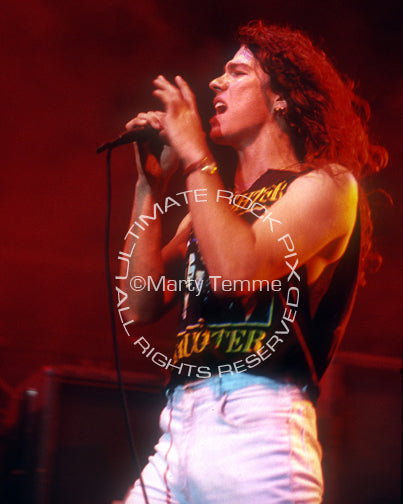 Photo of Mark Slaughter of Slaughter in concert in 1990 by Marty Temme