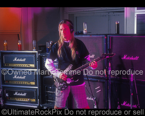 Photo of Jeff Hanneman of Slayer with his ESP guitar during a photo shoot in 1998 by Marty Temme