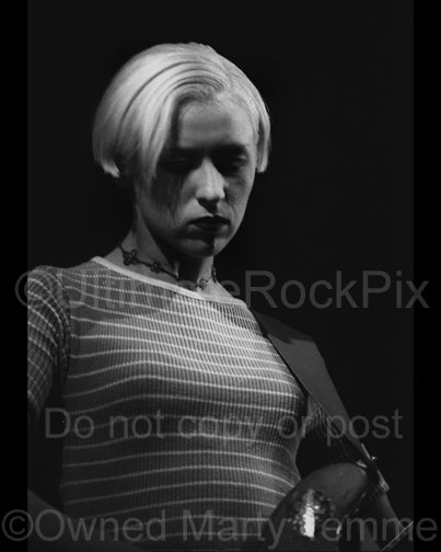 Black and white photo of D'arcy Wretzky of Smashing Pumpkins in concert in 1994 by Marty Temme