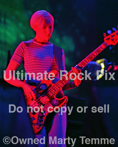 Photo of bassist D'arcy Wretzky of Smashing Pumpkins onstage in 1994 by Marty Temme