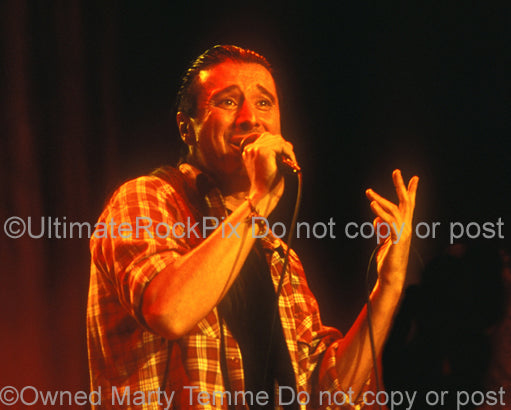 Photo of vocalist Steve Perry of Journey in concert in 1994 by Marty Temme