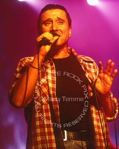Photo of Steve Perry of Journey in concert in 1994 by Marty Temme