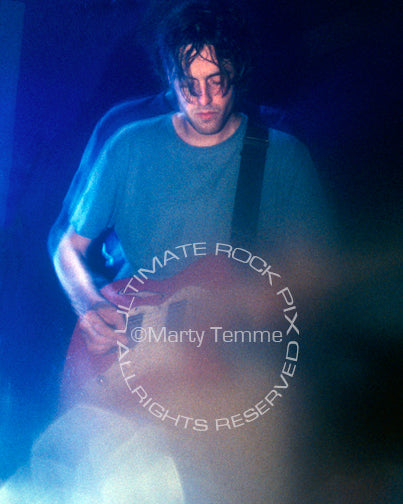 Photo of Jason Pierce of Spiritualized in concert in 1997 by Marty Temme
