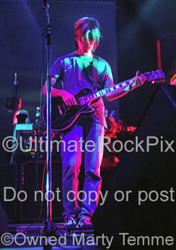 Photo of guitarist James Iha of Smashing Pumpkins in concert in 1994 by Marty Temme