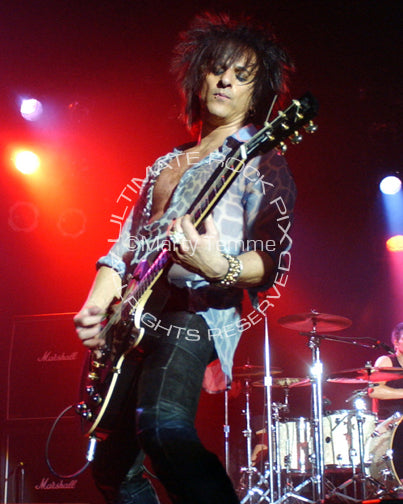 Photo of guitarist Steve Stevens playing a Les Paul in concert by Marty Temme