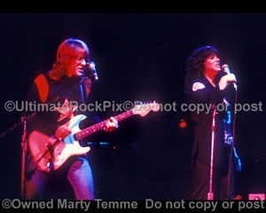 Photo of Paul Kantner and Grace Slick of Jefferson Starship in concert in 1975 by Marty Temme