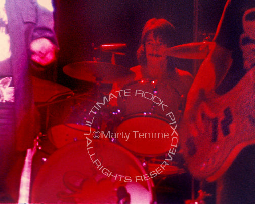 Photo of John Barbata of Jefferson Starship in concert in 1975 by Marty Temme