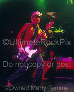 Photos of Bass Player Robert Deleo of Stone Temple Pilots Performing in Concert by Marty Temme