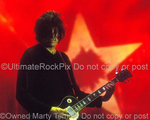Photos of Guitarist Dean DeLeo of Stone Temple Pilots Playing a Gibson Les Paul Standard in Concert in 2000 by Marty Temme