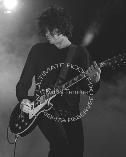 Black and white photo of Dean DeLeo in concert by Marty Temme