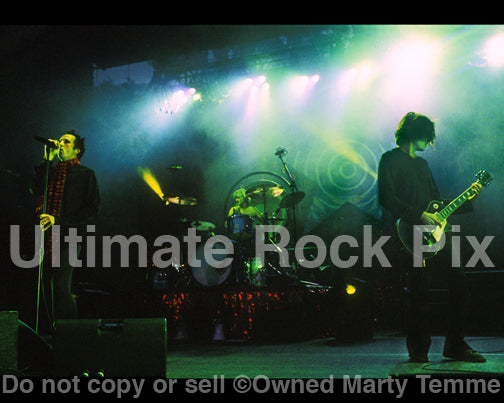 Photos of Scott Weiland, Dean DeLeo and Eric Kretz of Stone Temple Pilots by Marty Temme