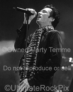 Black and white photo of vocalist Scott Weiland of Stone Temple Pilots in concert by Marty Temme