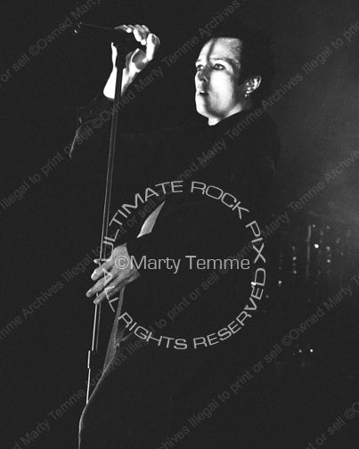 Black and white photo of Scott Weiland of Stone Temple Pilots performing onstage by Marty Temme