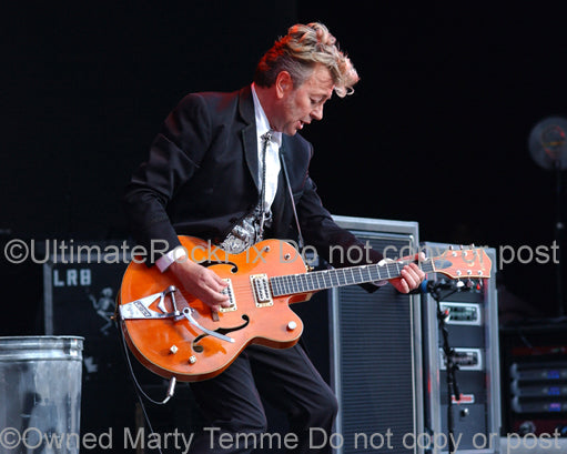Photo of Brian Setzer of The Stray Cats in concert with his Gretsch guitar by Marty Temme
