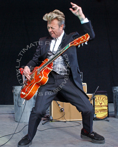Photo of Brian Setzer of The Stray Cats in concert by Marty Temme