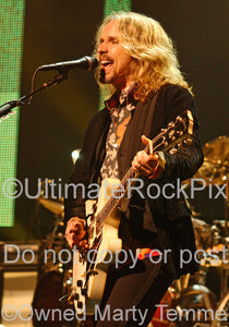 Photo of Tommy Shaw of Styx playing a Gibson 335 in concert by Marty Temme