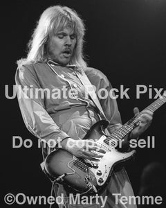 "Photo of James ""JY"" Young of Styx playing a Stratocaster in concert in 1979 by Marty Temme"