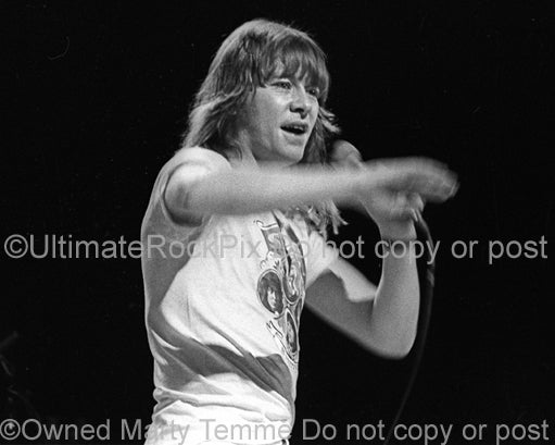 Photo of Brian Connolly of The Sweet performing in concert in 1976 by Marty Temme