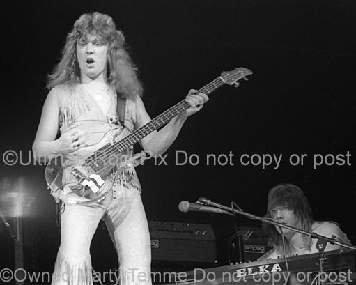 Photo of Steve Priest of The Sweet in concert in 1976 by Marty Temme