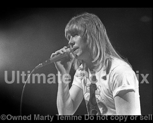 Photo of singer Brian Connolly of The Sweet in concert in 1976 by Marty Temme