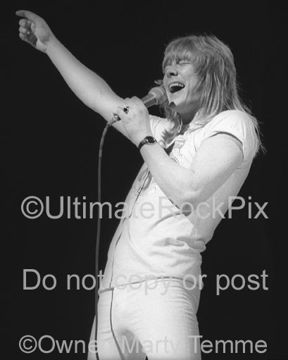 Photo of Brian Connolly of The Sweet in concert in 1976 by Marty Temme