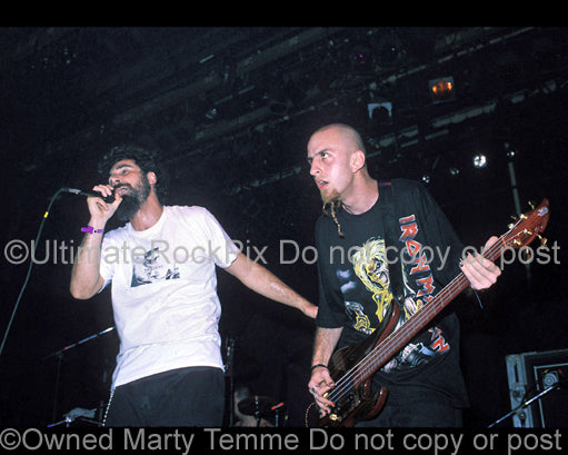 Photo of Serj Tankian and Shavo Odadjian of System of a Down in concert in 1998 by Marty Temme