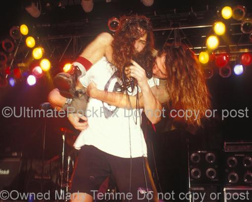 Photos of Chris Cornell Carrying Eddie Vedder on His Shoulders During a Temple of the Dog Concert in 1991 by Marty Temme