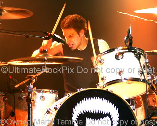 Photo of drummer Brian Tichy of Billy Idol in concert in 2005 by Marty Temme