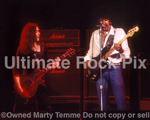 Photo of Gary Moore and Phil Lynott of Thin Lizzy in concert in 1977 by Marty Temme