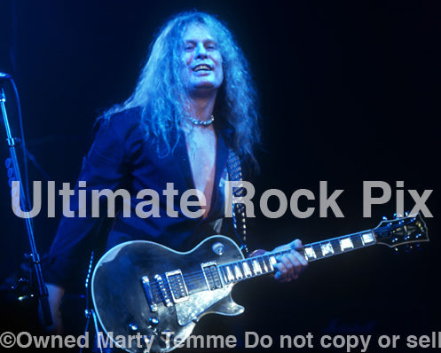 Photo of John Sykes of Thin Lizzy performing in concert in 2004 by Marty Temme