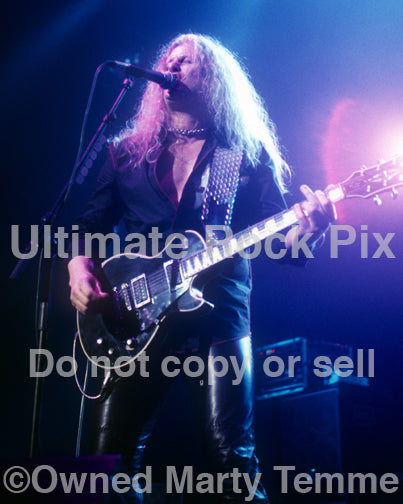 Photo of guitar player John Sykes of Thin Lizzy in concert in 2004 by Marty Temme