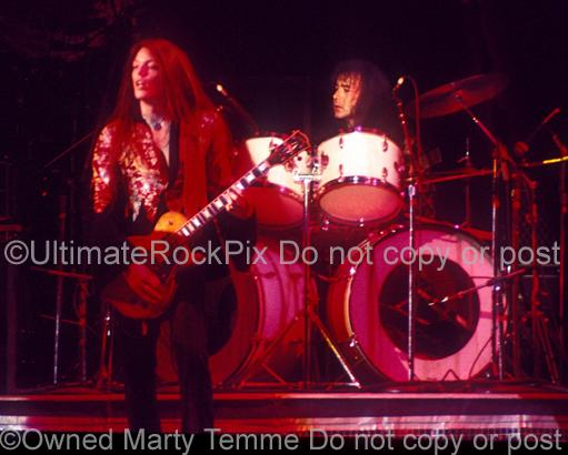 Photos of Scott Gorham and Brian Downey of Thin Lizzy in Concert in 1977 by Marty Temme