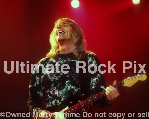 Photo of guitarist Scott Gorham of Thin Lizzy in concert in 2004 by Marty Temme