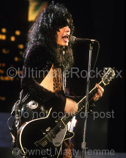 Photo of Tom Keifer of Cinderella playing a Gretsch guitar in 1990 by Marty Temme