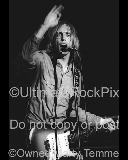 Photos of Musician Tom Petty Playing a Fender Stratocaster in Concert in 1978 by Marty Temme