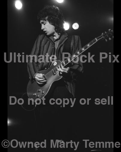 Photo of Mike Campbell of Tom Petty in concert in 1980 by Marty Temme