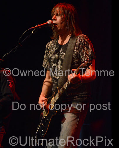 Photo of guitarist Pat Travers in concert in 2012 by Marty Temme