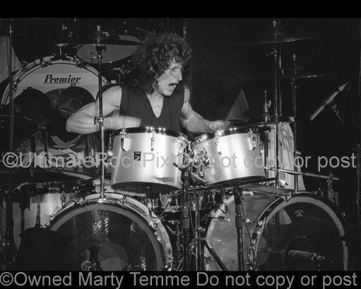 Photo of drummer Tommy Aldridge of Pat Travers in concert in 1979 by Marty Temme